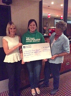 The cheque for £1,150 is presented to MacMillan Cancer Support